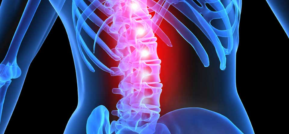 How common are spinal cord injuries in football?